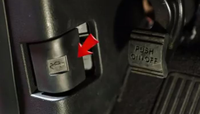 Pull the hood release lever
