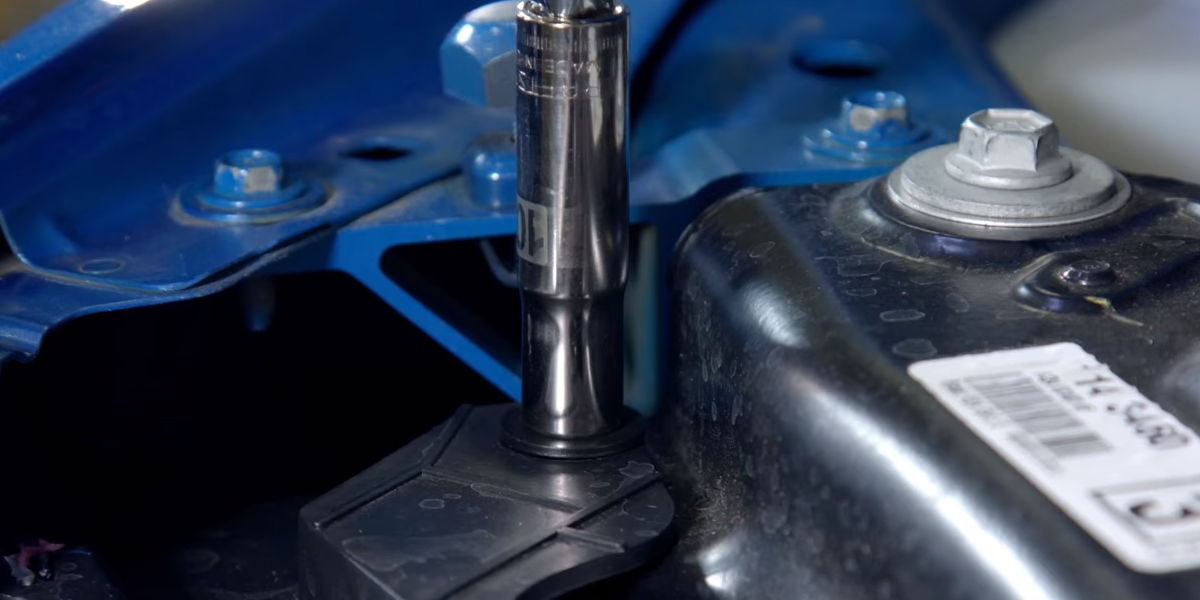 Remove 3 bolts that attach the headlights to the rad support and header panel
