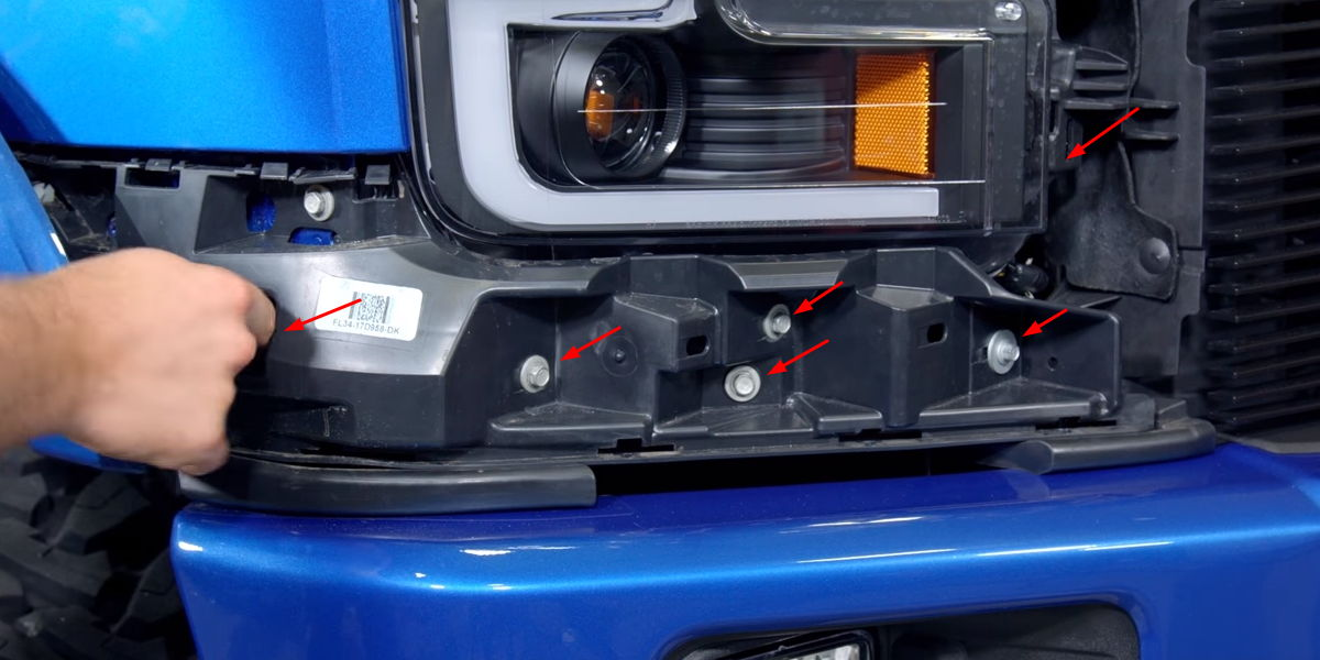 Remove all 10-mm bolts holding the lower panel